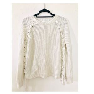 Ivory sweater with braided sides and ties